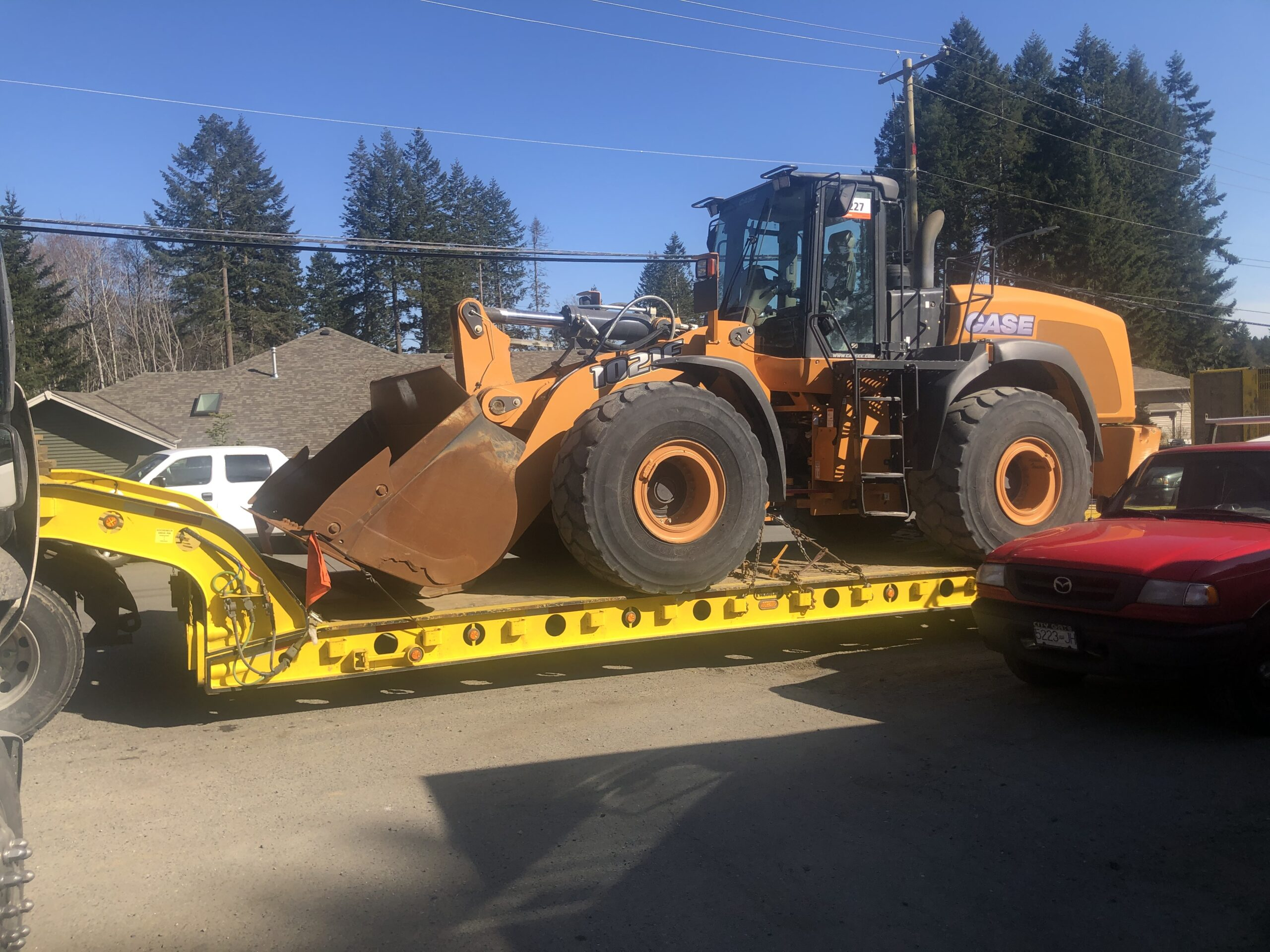 HB Towing a Wheel Loader