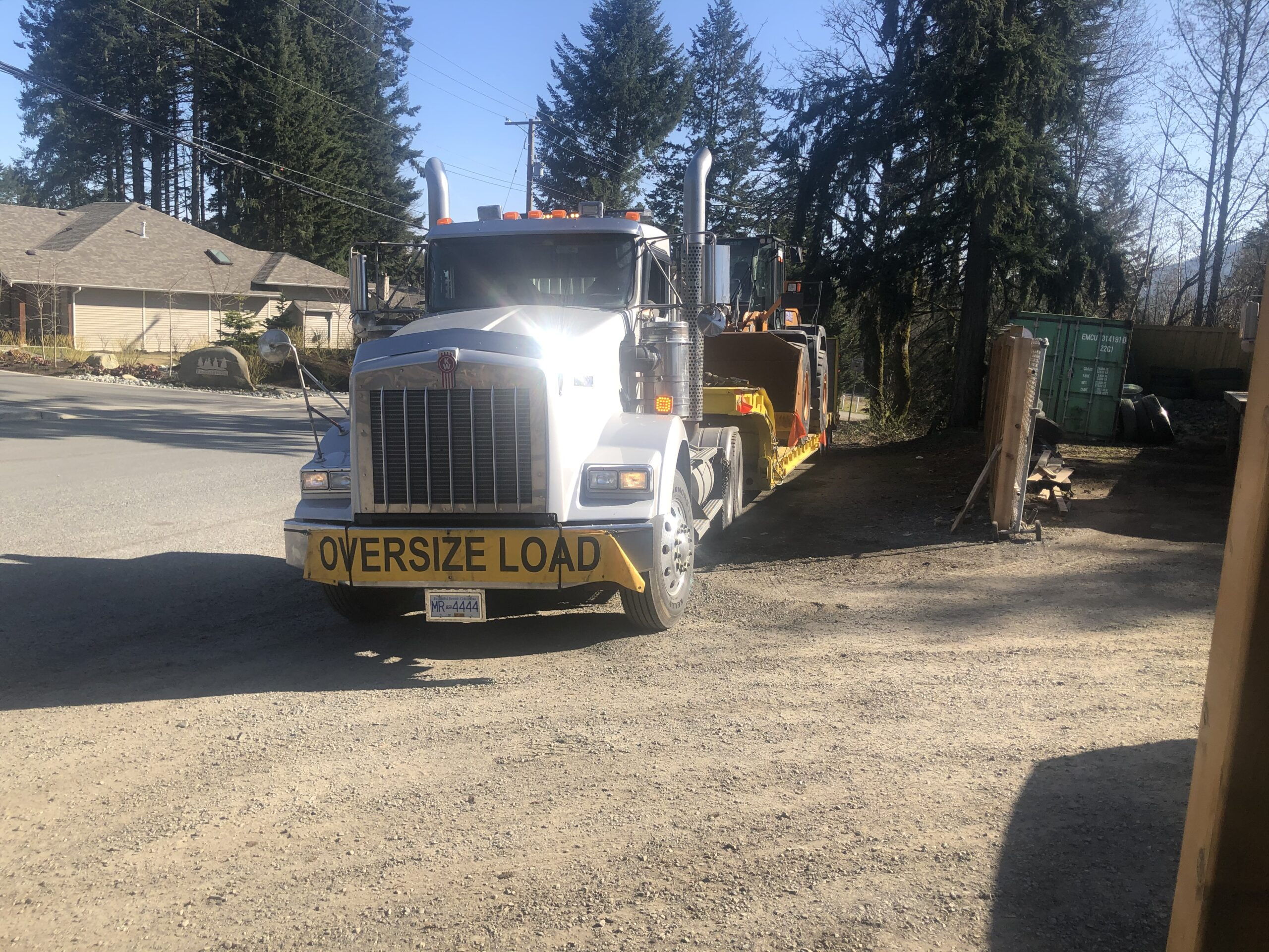 HB Towing towing a wheel loader