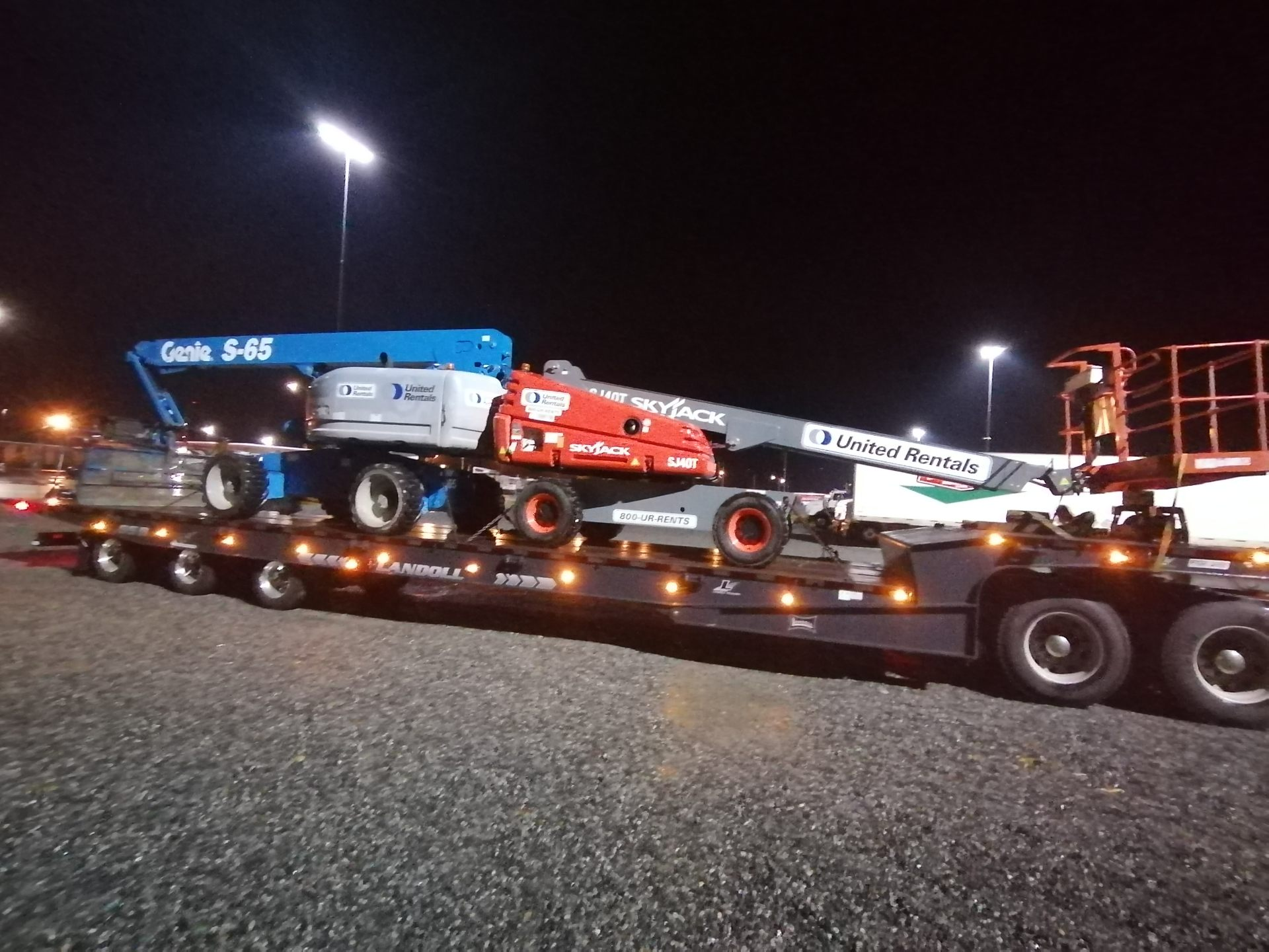 Basket lifts being towed by HB Towing